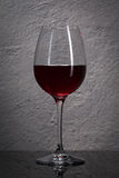 Glass. Red wine glass  in front of stone granite wall Stock Image
