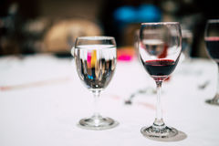 Glass of red wine and a glass of water on the table. Glass of red wine and a glass of water on the table in party Royalty Free Stock Photos