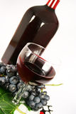 Glass red wine and grape Royalty Free Stock Image
