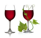 Glass of red wine and grape leaves Royalty Free Stock Images