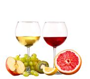 Glass of red wine grapefruit isolated. On a white background royalty free stock photography