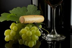 Glass of red wine with grapes Stock Photo
