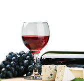 Glass of red wine with grapes Royalty Free Stock Image