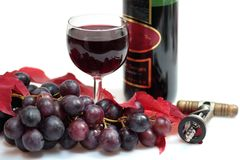 Glass of red wine and grapes Royalty Free Stock Photos