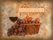 Glass of red wine and grapes background. Glass of red wine and grapes on texture of old paper Royalty Free Stock Image