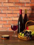 Glass of red wine , grapes and cheese. Varieties Stock Photography