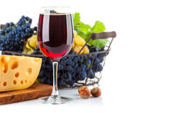 Glass red wine with grapes and cheese. On white background Royalty Free Stock Images