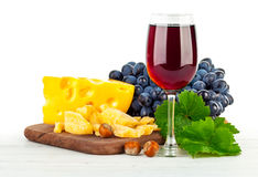 Glass red wine with grapes and cheese. On white background Stock Photos