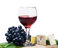 Glass of red wine with grapes Royalty Free Stock Photo