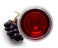 Glass of red wine and grapes. Isolated on white background from top view Stock Images