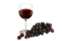 Glass of red wine and grapes Stock Photography