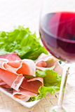 Glass with red wine and ham Stock Image