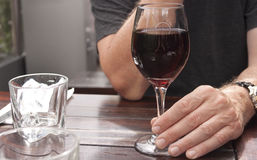 Glass of red wine with hand Stock Image