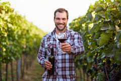 Glass of red wine in hand Royalty Free Stock Photos