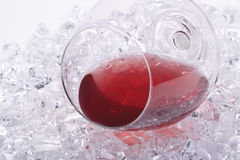Glass of red wine on the ice cubes Stock Photography