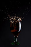 Red wine splash. Glass of Red Wine isolated on a black background Stock Images