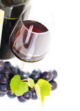 Glass of a red wine isolated on white Royalty Free Stock Images