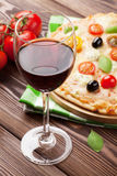 Glass of red wine and italian pizza Royalty Free Stock Photo