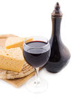 Glass of red wine, jug and cheese Stock Images