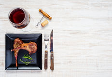 Glass Red Wine with Lamb Chops on Copy Space Area Stock Photos