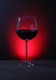 Glass of Red Wine with Lights Background Royalty Free Stock Images