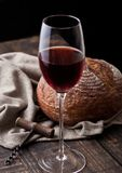 Glass of red wine with loaf of bread in kitchen Royalty Free Stock Images