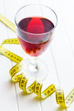 Glass of red wine. Glass of red wine and measuring tape. Diet concept stock photography