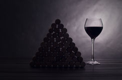 Glass with red wine near wine jams Royalty Free Stock Images