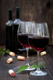 Glass of red wine on old wooden table Royalty Free Stock Photo