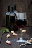 Glass of red wine on old wooden table Stock Photo