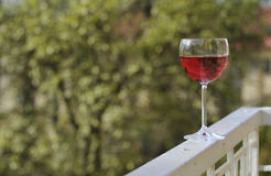 Glass of red wine out. Royalty Free Stock Images