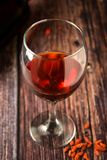 Glass of red wine over rustic, wooden textured table. Dark photo. Glass of red wine over rustic, wooden textured table, background, party, food, vintage, summer stock images