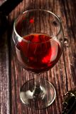Glass of red wine over rustic, wooden textured table. Dark photo. Glass of red wine over rustic, wooden textured table, background, party, food, vintage, summer royalty free stock photography