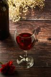Glass of red wine over rustic, wooden textured table. Dark photo. Glass of red wine over rustic, wooden textured table, background, party, food, vintage, summer stock photos