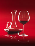 Glass of red wine and pitcher Stock Image