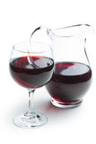 Glass of red wine with pitcher Stock Images