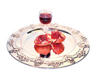 Glass of red wine and pomegranate isolated Royalty Free Stock Image