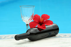 A glass of red wine by the pool royalty free stock photo