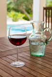 Glass of red wine in poolside stock photography