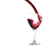 Glass of Red Wine Pouring Royalty Free Stock Photos