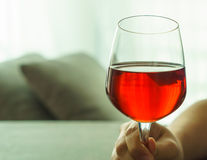 Glass of red wine raised Stock Images