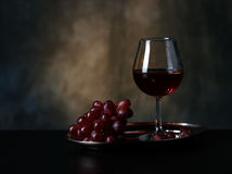 Glass of red wine and red grapes Royalty Free Stock Photography