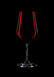 Glass of red wine with reflection on black Royalty Free Stock Photo