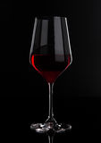Glass of red wine with reflection on black Stock Photography