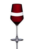 Glass of red wine with reflection on white Royalty Free Stock Images