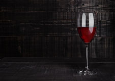 Glass of red wine with reflections on wooden board. Background Royalty Free Stock Photos
