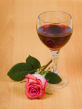 Glass of red wine and rose stock photos