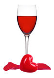 Glass of Red Wine, rose petals and heart isolated on white Royalty Free Stock Photography