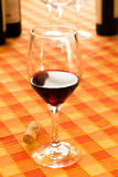 Glass of red wine in the rustic tablecloth Stock Photography