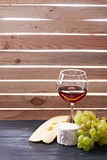 Glass of red wine, served with grapes and cheese Stock Photos